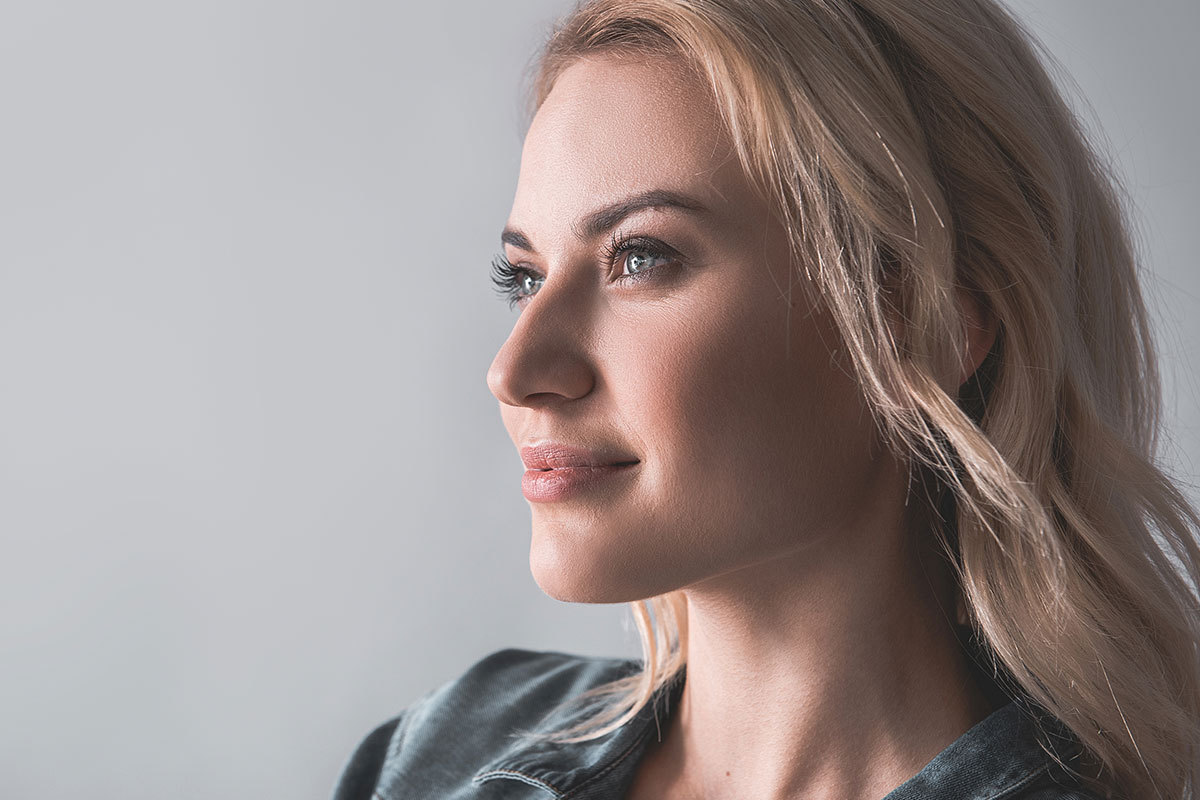 Woman Loves her Youthful Neck thanks to Anti-Aging Neck Technology at Maningas Cosmetic Surgery
