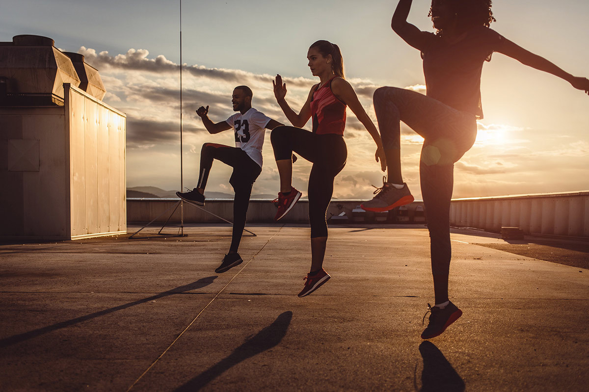 Group of Friends Working Out Together to Reduce Stress