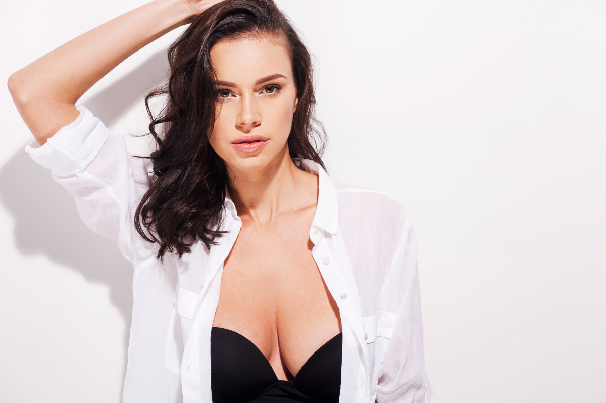Glamorous Woman Happy With Breast Implants from Maningas Cosmetic Surgery