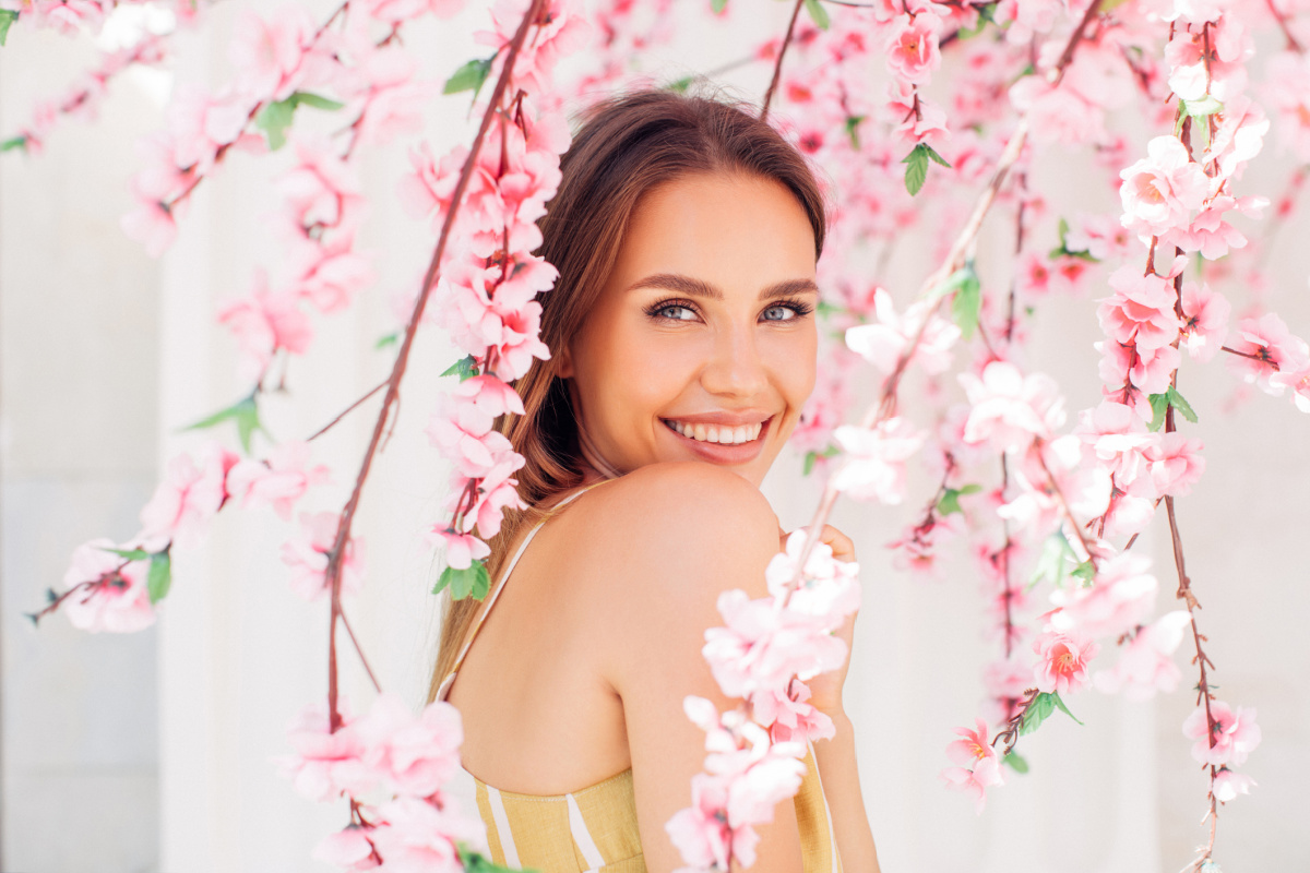 Woman in Spring Flowers Smiling